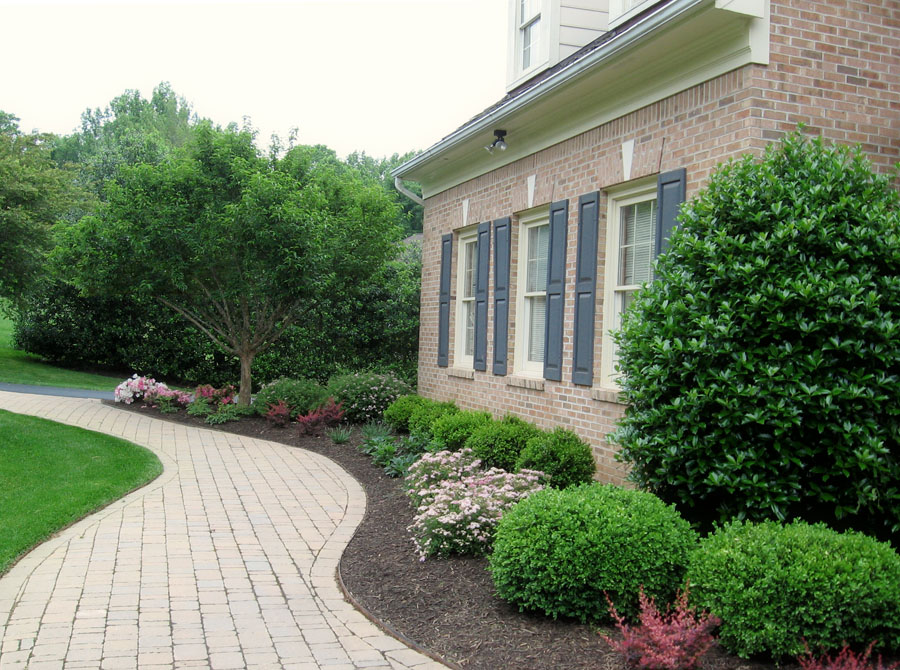 Generous foundation plantings nestle this home into the landscape.