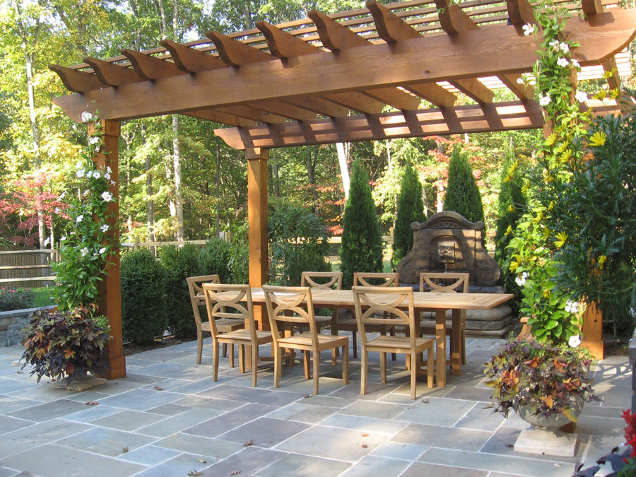 cedar pergola a cedar pergola offers shade to an outdoor dining area ...